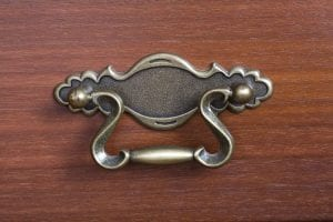 close-up of an antique drawer handle