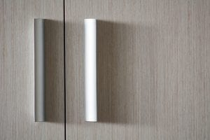 Background wooden texture door with plastic metallic handles